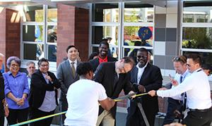 Principal Kibby Kleiman cuts the ribbon at the PVHS grand opening celebration.