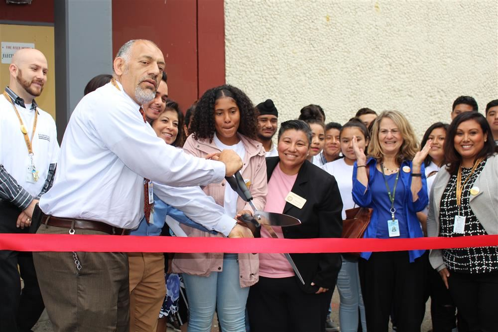RHS Principal Jose De Leon cutting the ribbon to the new Internationals Academy