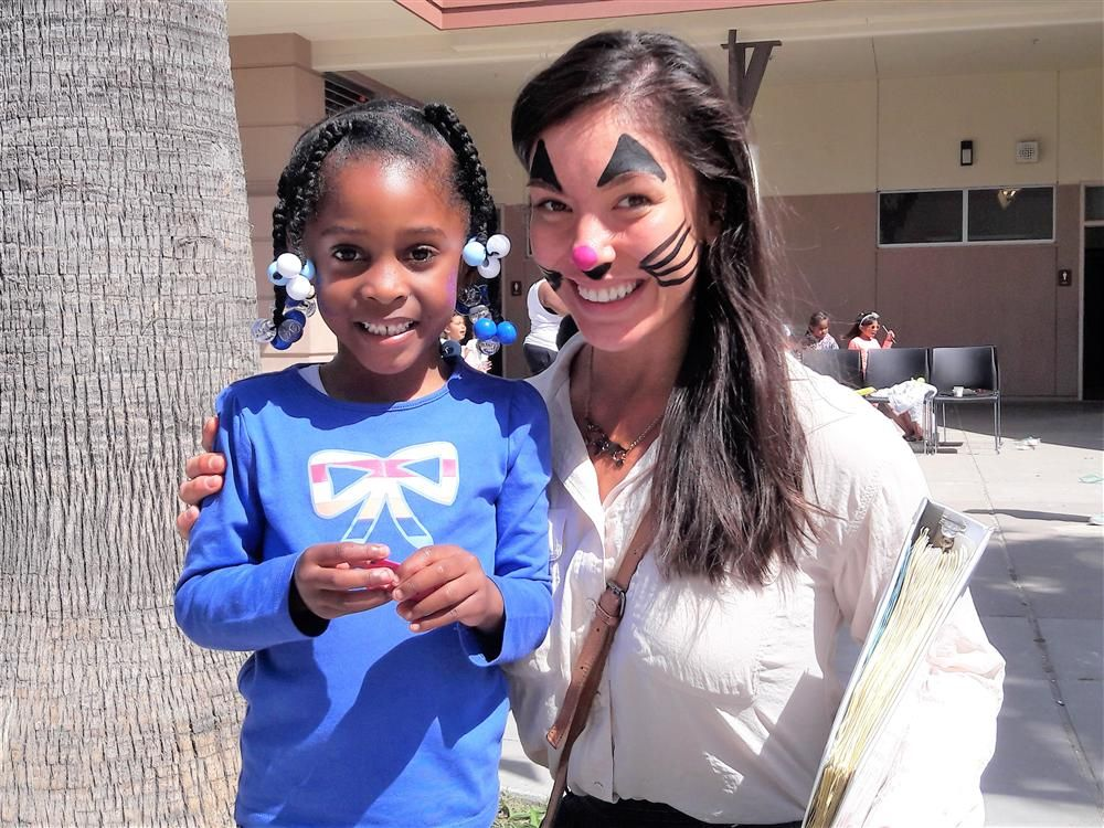 Downer PreK teacher Areli Carreon and a student celebrate Dia del Nino
