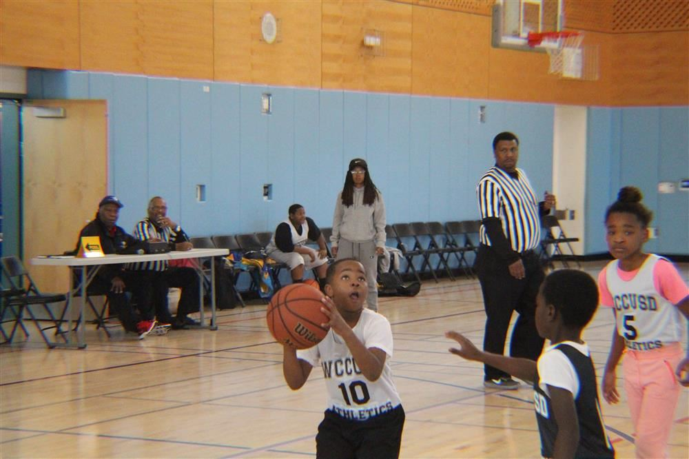 Elementary school students from the Kennedy Family of Schools participate in a basketball league