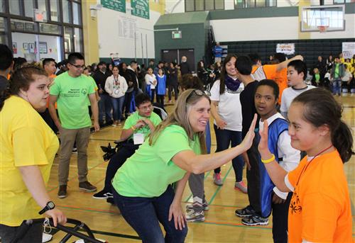 De Anza High School's team congratulates one another at the 3rd Annual Special Olympics Basketball Tournament.