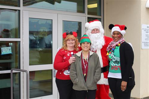 Jim Gant (aka Santa) and the Purchasing Department team after delivering gifts to kindergartners at King Elementary School.