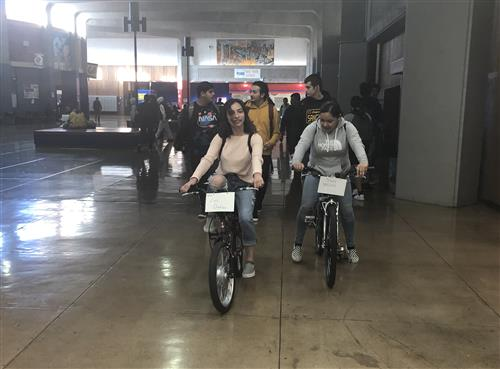 Richmond High Student ride their bikes to the track for the 8th annual E-Bike Challenge