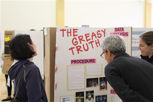 Volunteer judges take a look at Science/STEM projects for the District's annual Science/STEM Fair.
