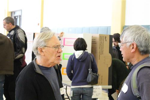 WCCUSD Science/STEM Fair judge Dennis Claudio, right, has been participating for 19 years.