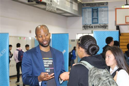 UC Berkeley Financial Aid Outreach and Communications liaison Jamal Collins talks with Hercules High School students.