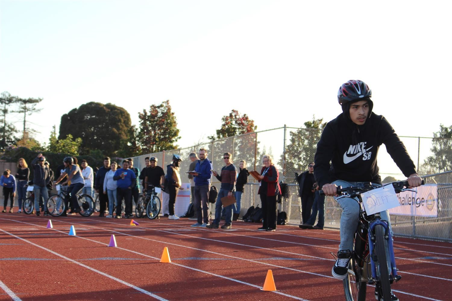 Richmond High School student on his bike for the 8th annual E-Bike Challenge