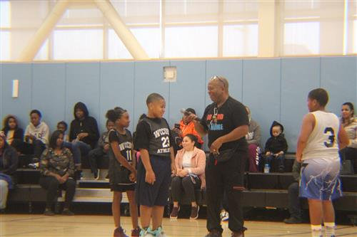 WCCUSD's George Brown opens the elementary school basketball league by asking students what core value they want to highlight