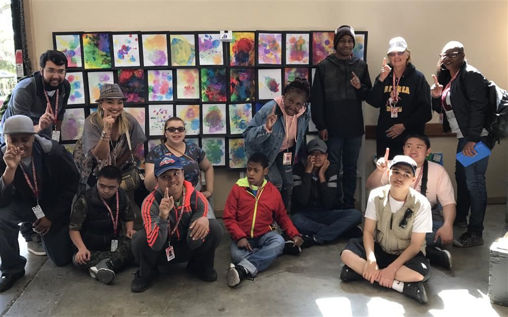 De Anza Students Pose before their 1st Place Artwork