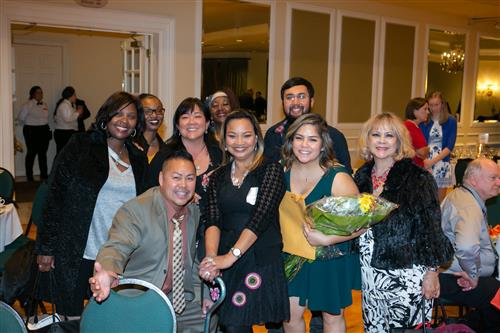 De Anza High School teacher Myrna Hadjirul, center, with De Anza and WCCUSD family and friends at the Eukel Award Dinner