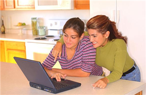 Mom and daughter using laptop