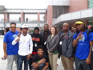 De Anza High School football players and staff pose for a picture after the schools National Signing Day event