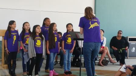 Students from Coronado Elementary School sing during the grand opening celebration.